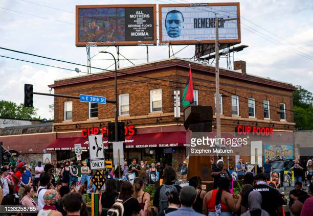 People gather at George Floyd Square in the evening after the removal of barricades and pieces of memorial on June 3, 2021 in Minneapolis, Minnesota....
