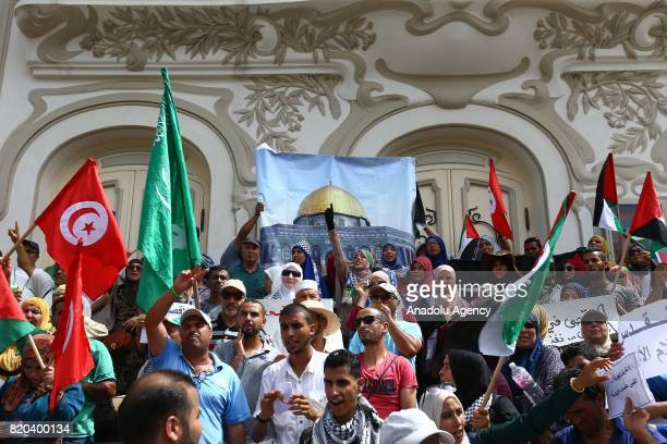People gather at Habib Bourguiba Avenue holding Palestinian flags to protest Israeli violations and restrictions on Al Aqsa Mosque on July 21 2017 in...