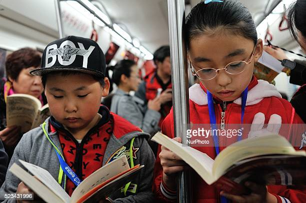 People gather at Harbin subway station to attend the reading a book quietly lounge event on the occasion of the World Book Day to arouse the...