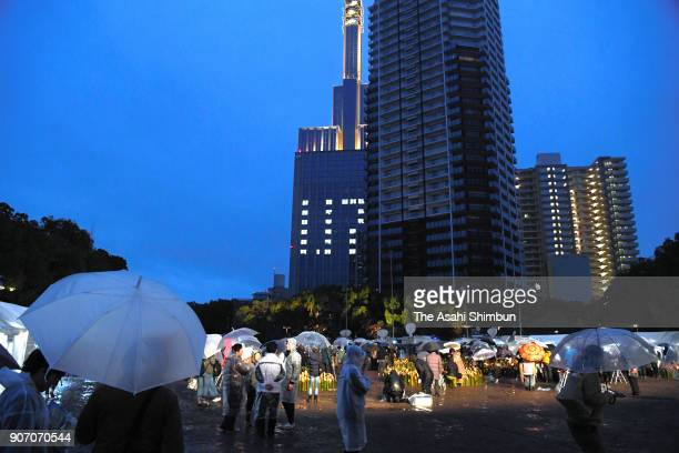 People gather at Higashi Yuenchi Park to commemorate the victims on the 23rd anniversary of the Great Hanshin Earthquake on January 17 2018 in Kobe...