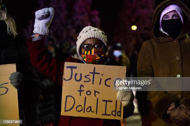 People gather at Holiday gas station where Dolal Idd was shot and killed by Minneapolis Police for a vigil on December 31, 2020 in Minneapolis,...