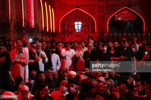 People gather at Imam Ali Holy Shrine for a commemoration ceremony for the upcoming 1360th death anniversary of Imam Ali ibn Abi Talib, cousin of the...