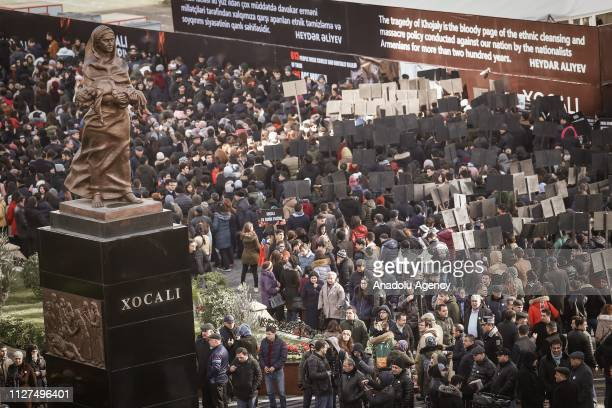 People gather at 'Khojaly Genocide Memorial' on the 27th anniversary of 'Khojaly Massacre' in Baku Azerbaijan on February 26 2019 The death toll in...
