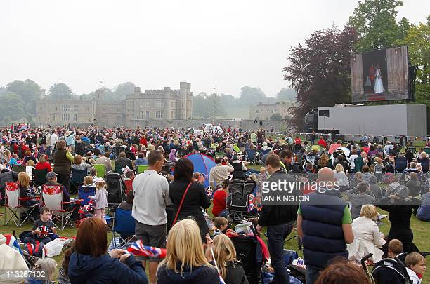 People gather at Leeds Castle in Kent, southeastern England, to watch a broadcast feed of the Royal wedding of Britain's Prince William and Kate...