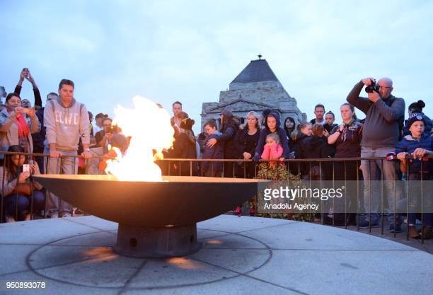 People gather at Melbourne's Shrine of Remembrance to pay their respects during the dawn service of the ANZAC day in Melbourne Australia on April 25...