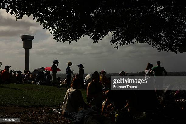 People gather at Observatory Hill to welcome in the New Year on New Year's Eve on Sydney Harbour on December 31 2014 in Sydney Australia