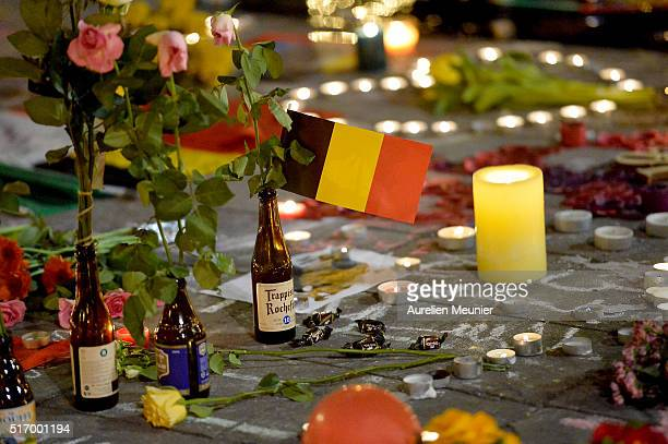 People gather at Place de la Bourse in support of the victims after the terrorist attacks on March 22 2016 in Brussels Belgium At least 31 people are...
