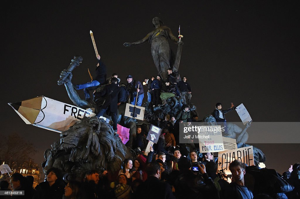People gather at Place de la Nation, following a mass unity rally following thousands of people marching from Place de la Republique on route to Place de la Nation, following the recent terrorist attacks on January 11, 2015 in Paris, France. An estimated one million people have converged in central Paris for the Unity March joining in solidarity with the 17 victims of this week's terrorist attacks in the country. French President Francois Hollande led the march and was joined by world leaders in a sign of unity. The terrorist atrocities started on Wednesday with the attack on the French satirical magazine Charlie Hebdo, killing 12, and ended on Friday with sieges at a printing company in Dammartin en Goele and a Kosher supermarket in Paris with four hostages and three suspects being killed. A fourth suspect, Hayat Boumeddiene, 26, escaped and is wanted in connection with the murder of a policewoman.