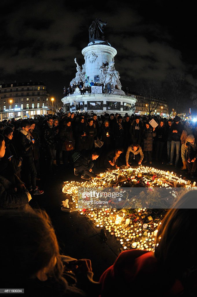 People gather at Place de la Republique in solidarity with the victims of yesterday's terrorist attack on the satirical newspaper Charlie Hebdo on January 8, 2015 in Paris, France. France is on maximum security threat level after twelve people were killed, including two police officers, at the offices of the satirical magazine Charlie Hebdo in Paris. French Police have made seven arrests in connection with the attack in which they have named two main suspects, brothers Cherif and Said Kouachi. A further blow to the country came this morning when a gunman killed a policewoman in the southern suburb of Montrouge.