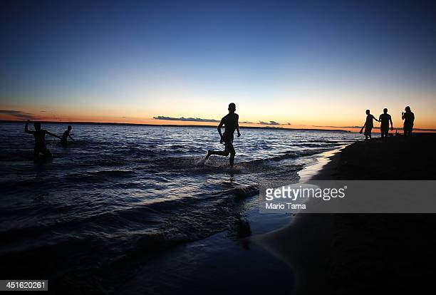 People gather at Ponta Negra beach on Rio Negro a branch of the Amazon River on November 23 2013 in Manaus Brazil Manaus' Arena Amazonia will be a...