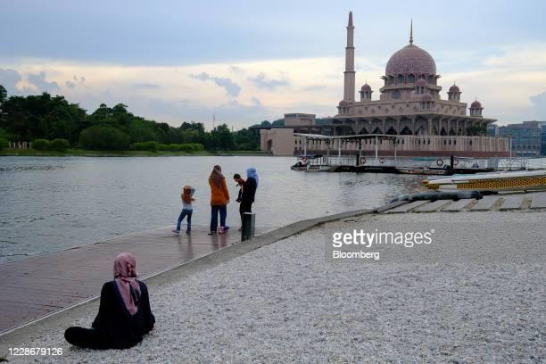 People gather at Putrajaya Lake near the Putra Mosque in Putrajaya Malaysia on Wednesday Sept 23 2020 Malaysia's Prime Minister Muhyiddin Yassin...