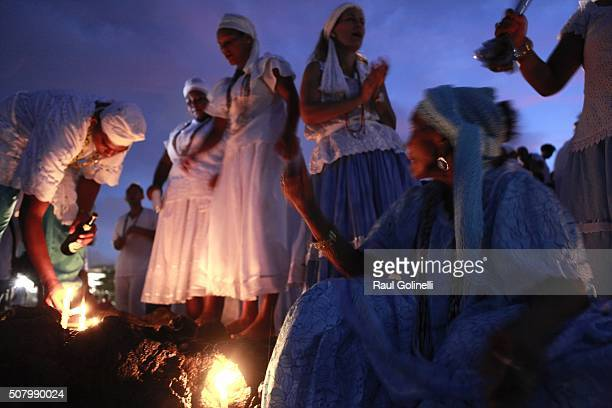 People gather at Rio Vermelho beach to celebrate Yemanja day on February 2 2016 in Salvador Brazil Yemanja is a powerful goddess of the sea in the...