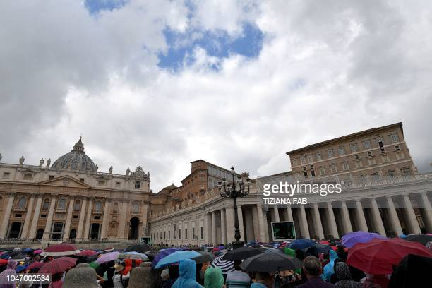 People gather at Saint Peter's square during Pope Francis Sunday Angelus prayer on October 7 2018