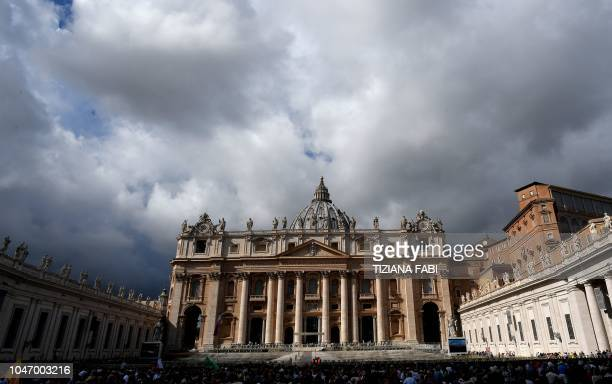 People gather at Saint Peter's square during Pope Francis's sunday Angelus prayer from the window of the apostolic palace on October 7 2018 at the...