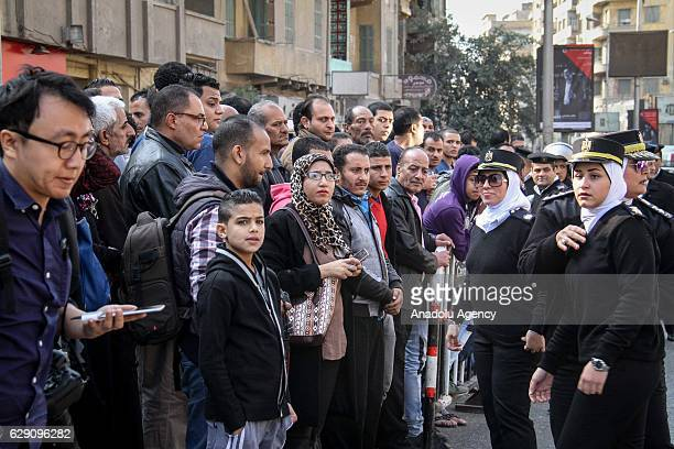 People gather at site after an explosion at Saint Mark's Coptic Orthodox Cathedral in Cairo Egypt on December 11 2016