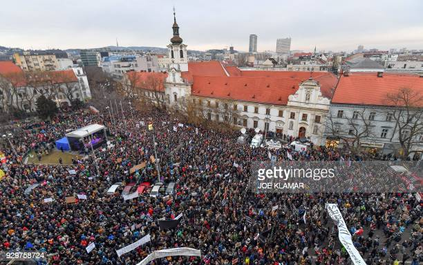 TOPSHOT People gather at Slovak National Uprising square during a rally under the slogan For a Decent Slovakia against corruption and to pay tribute...