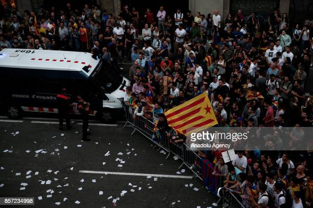 People gather at Spanish police headquarters to stage a demonstration supporting Catalonian independence and reacting against Spanish police's...
