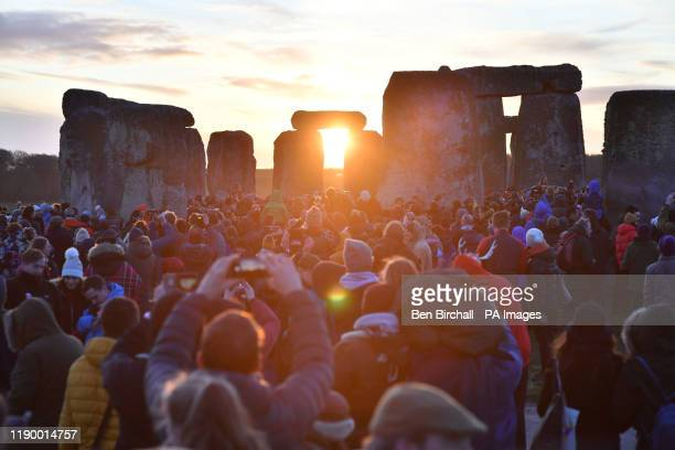 People gather at Stonehenge in Wiltshire to mark the winter solstice, and to witness the sunrise after the longest night of the year.