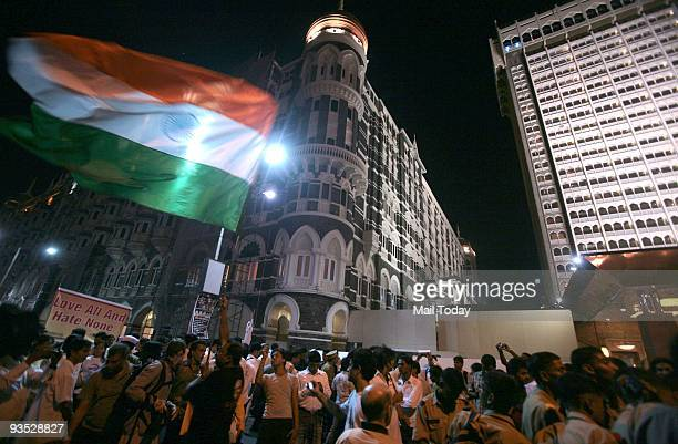 People gather at Taj Mahal Hotel to pay tributes to the victims and martyrs of 26/11 terror attacks on the first anniversary of the attacks in Mumbai...