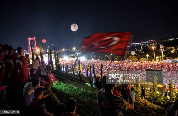People gather at the 15 July Martyrs bridge to commemorate the July 15 2016 coup anniversary in Istanbul on July 15 2018 Turkey on commemorated the...