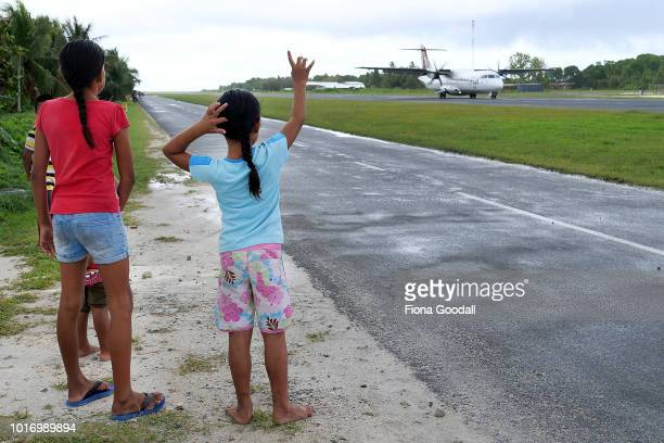 People gather at the airport three times a week to welcome and farewell passengers from Suva Fiji on August 15 2018 in Funafuti Tuvalu The siren is...