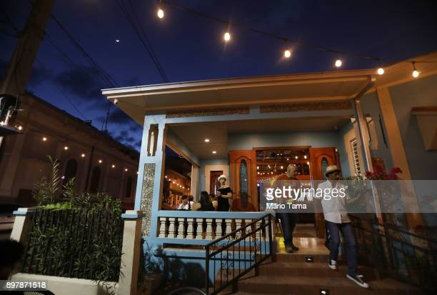 People gather at the Andares Bistro on December 22 2017 in Utuado Puerto Rico Owners said they opened their doors two weeks after Hurricane Maria hit...