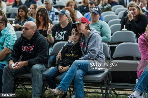 People gather at the Ascend Amphitheater for a vigil honoring the victims of the mass shooting in Las Vegas on October 2 2017 in Nashville Tennessee...