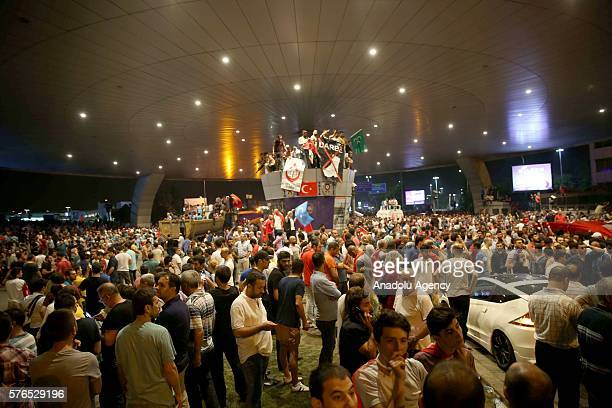 People gather at the Ataturk Airport to react against military coup attempt in Istanbul Turkey on July 16 2016