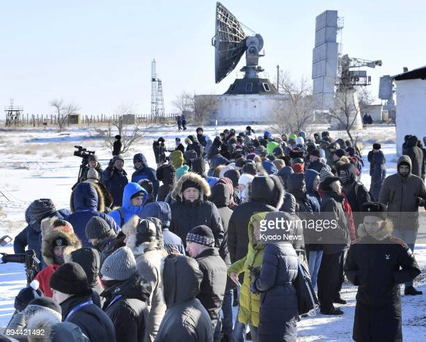 People gather at the Baikonur Cosmodrome in Kazakhstan on Dec 17 2017 to watch the scheduled launch later in the day of a Russian Soyuz spacecraft...