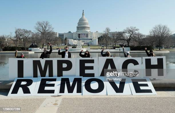 People gather at the base of the U.S. Capitol with large IMPEACH and REMOVE letters on January 12, 2021 in Washington, DC. The group is calling on...