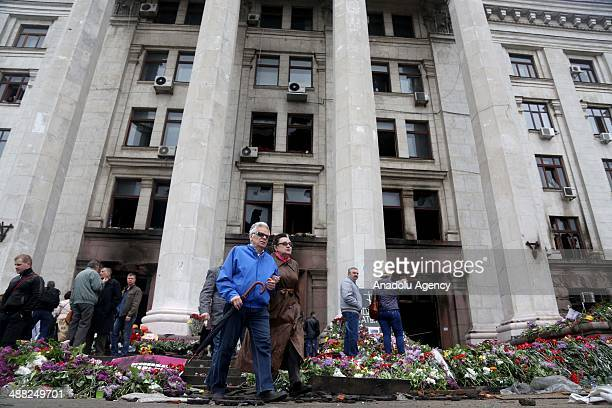 People gather at the burnt Trade Union building in memory of people killed in recent clashes in the South-Ukrainian city of Odessa, Ukraine, on May...