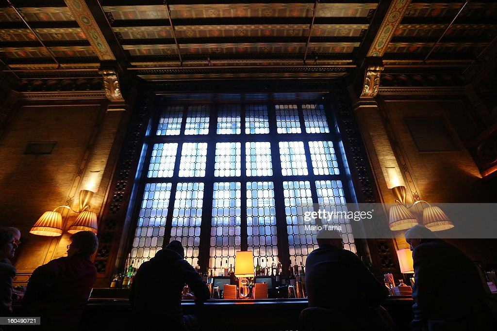 People gather at the Campbell Apartment at Grand Central Terminal during celebrations on the day the famed Manhattan transit hub turns 100 years old on February 1, 2013 in New York City. The space was formerly the private salon and office of 1920's railroad tycoon Joseph Campbell. Grand Central Terminal opened in 1913 and is the world's largest terminal covering 49 acres with 33 miles of track. Each day 700,000 people pass through the terminal where Metro-Noth Railroad operates 700 trains per day.