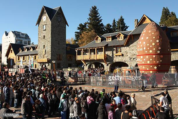 People gather at the Civic Centre of San Carlos de Bariloche in the foothills of the Andes in the province of Rio Negro Argentina on April 8 2012 to...