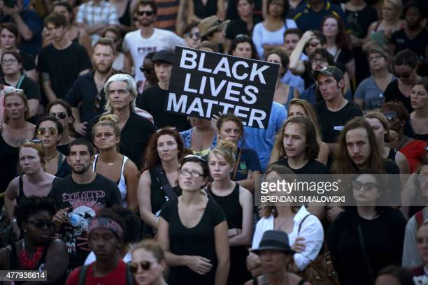 People gather at the Confederate Museum during a protest in Charleston South Carolina on June 20 2015 The group gathered to protest violence and...