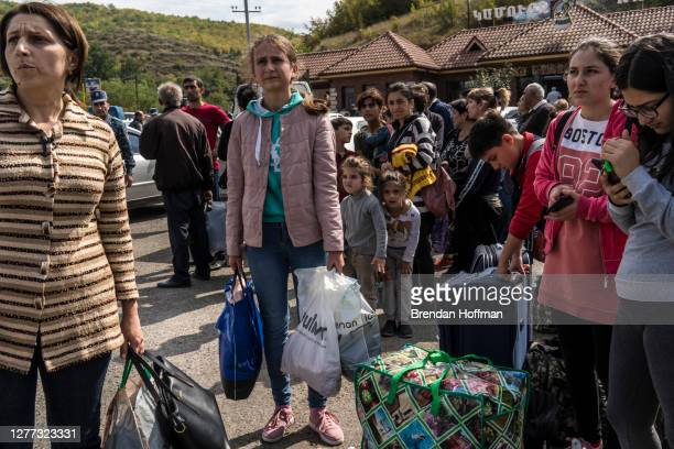 People gather at the edge of the city seeking rides in the direction of Yerevan, away from the fighting in Nagorno-Karabakh, on September 29, 2020 in...