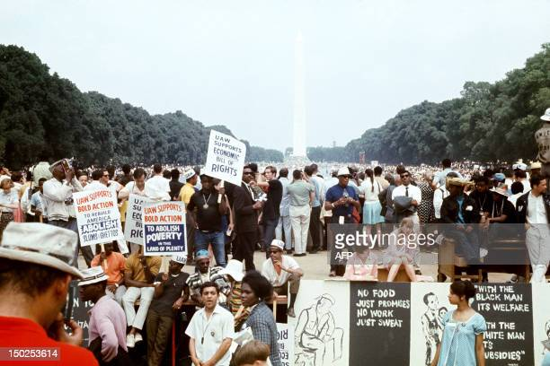 People gather at the end of the Poor People March, on June 19 in Washington DC. The Poor People's Campaign was organized in 1968 by Martin Luther...