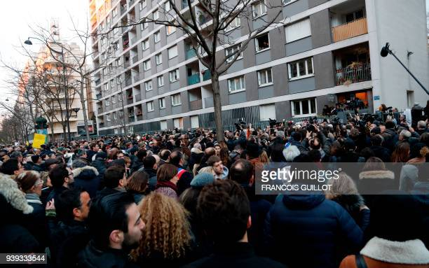 People gather at the entrance to the apartment building in Paris on March 28 at the conclusion of a march in memory of Mireille Knoll the 85yearold...