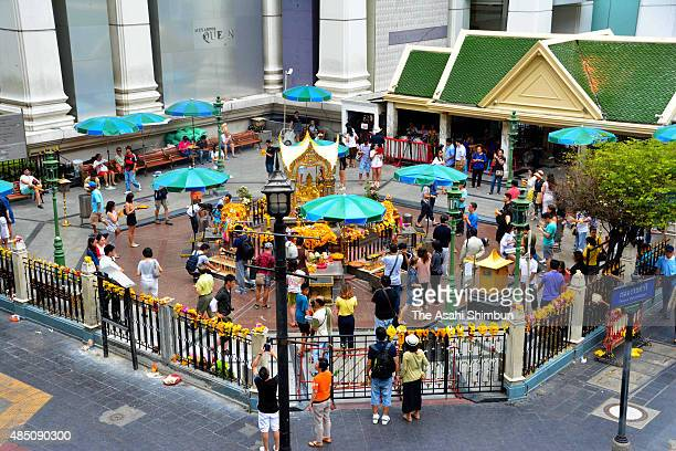 People gather at the Erawan Shrine on August 23, 2015 in Bangkok, Thailand.