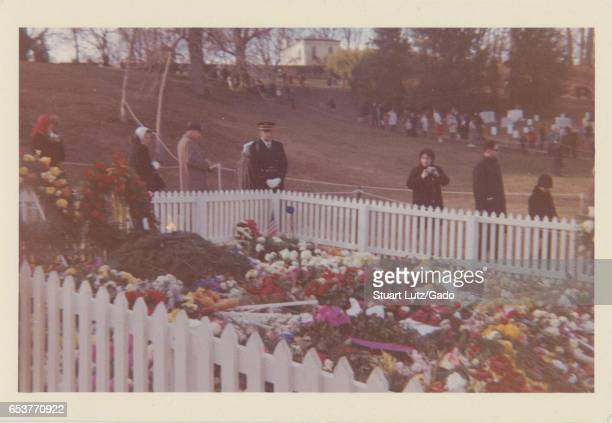 People gather at the grave of assassinated United States President John F Kennedy shortly after his death at Arlington National Cemetery Arlington...