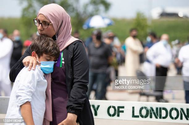 People gather at the Islamic Centre of Southwest Ontario on June 12 to pay their respects at the funeral of four members of the Afzaal Family, in...