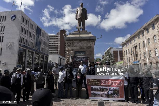 People gather at the Joshua Nkomo statue ahead of Unity Day commemorations on December 22 2017 in Bulawayo Zimbabwe to commemorate the killing that...