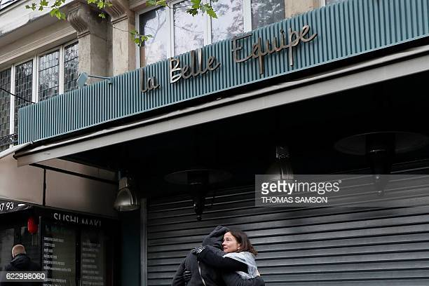 People gather at the La Belle Equipe bar and restaurant in Paris on November 13 after a ceremony to mark the first anniversary of the Paris terror...