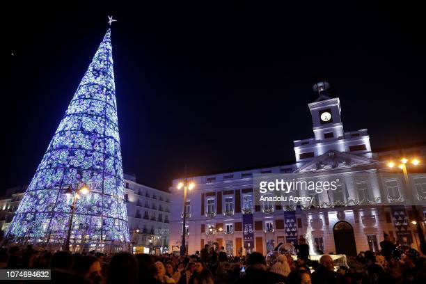People gather at the lightened Puerta del Sol Square ahead of the new year in Madrid Spain on December 23 2018