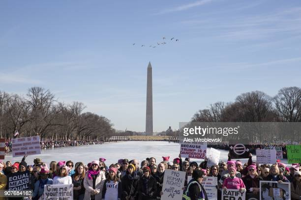 People gather at the Lincoln Memorial reflecting pool to rally before the Women's March on January 20 2018 in Washington DC Across the nation...