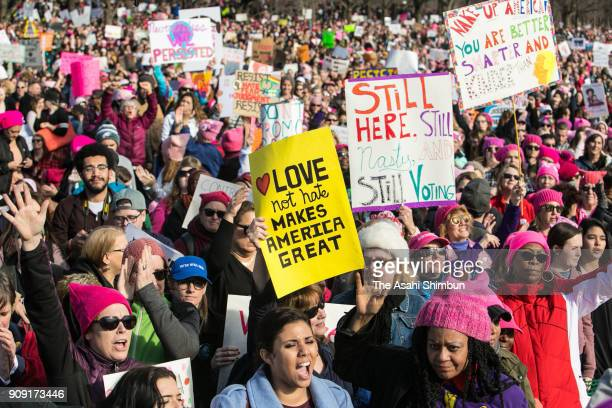 People gather at the Lincoln Memorial reflecting pool to rally before the Women's March on January 20 2018 in Washington DC Across the nation people...