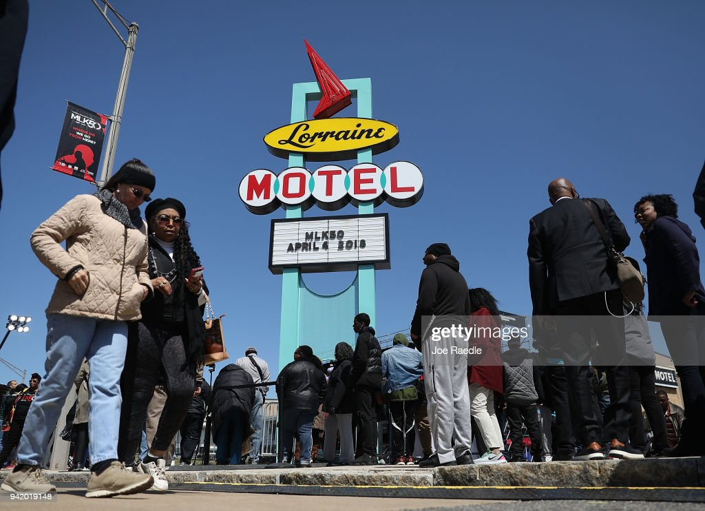 People gather at the Lorraine Motel, where Dr. Martin Luther King, Jr. was assassinated and is now part of the complex of the National Civil Rights Museum, as they reflect on the 50th anniversary of his assassination on April 4, 2018 in Memphis, Tennessee. The city is commemorating his legacy on the anniversary of his death on the balcony outside his hotel room 306 on April 4, 1968.