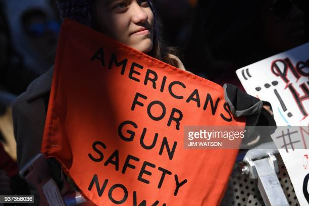 People gather at the March for Our Lives Rally in Washington, DC on March 24, 2018. Galvanized by a massacre at a Florida high school, hundreds of...