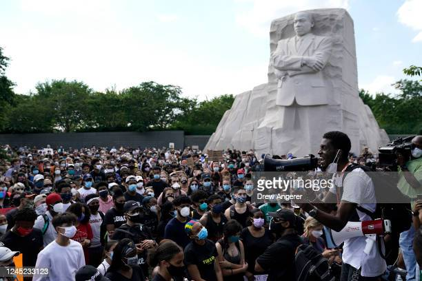 People gather at the Martin Luther King Jr Memorial during a peaceful protest against police brutality and the death of George Floyd on June 4 2020...