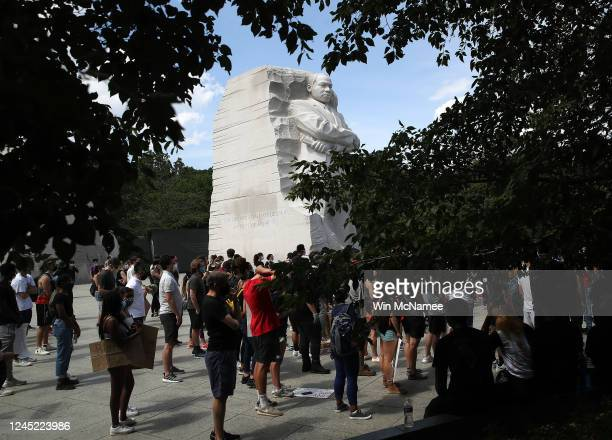 People gather at the Martin Luther King Jr Memorial to protest against police brutality and the death of George Floyd on June 4 2020 in Washington DC...
