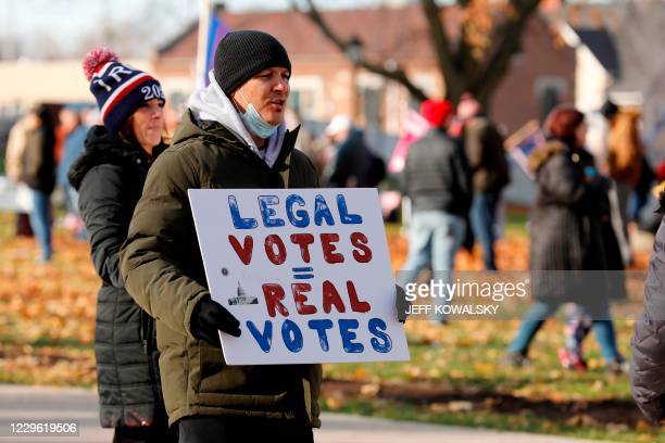"""People gather at the Michigan State Capitol for a """"Stop the Steal"""" rally in support of US President Donald Trump on November 14 in Lansing, Michigan...."""